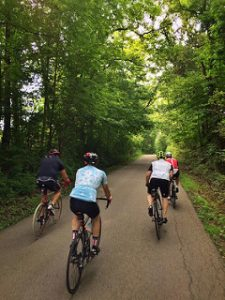 Group cycling on paved trail